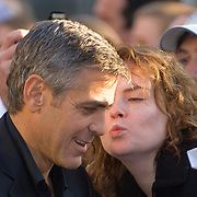 LONDON, Leicester Square  8th April 2008 A kiss for George . George Clooney, director and star of Leatherheads .and his leading lady and fellow Oscar winner Renee Zellweger unveil their new romantic comedy .at the film's European Premiere  in London's Odeon Leicester Square.