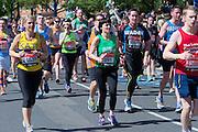 London. United Kingdom. 2014 London Marathon.  Narrow Street Limehouse, East London. Athletics 12:37:20  Sunday  13/04/2014  [Mandatory Credit; Peter SPURRIER/ Intersport Images],