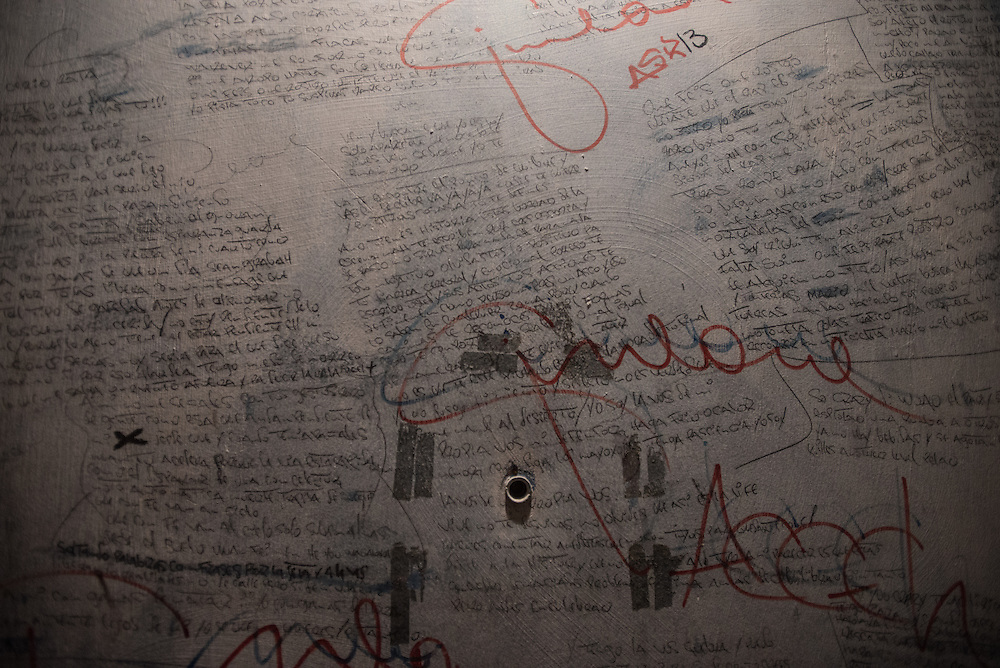 "MARACAY, VENEZUELA - JULY 4, 2016: Original hip hop songs written on the bedroom walls of schizophrenic Accel Simione. On days when there is enough medicine to clear his mind, Accel writes new hip-hop lyrics. He has written dozens of songs, one was about his relationship with his brother Gerardo, who is also schizophrenic. Another, called ""The Lights Are Out,"" tells of the constant blackouts his neighborhood faces.  PHOTO: Meridith Kohut for The New York Times"