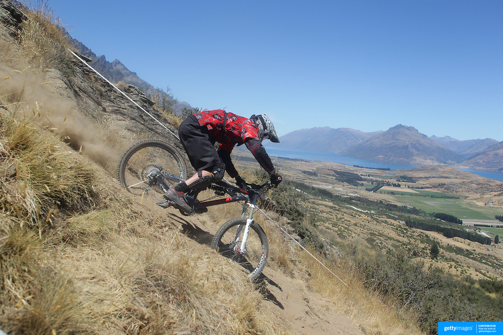 Michael Williamson from Wellington in action during the New Zealand South Island Downhill Cup Mountain Bike series held on The Remarkables face with a stunning backdrop of the Wakatipu Basin. 150 riders took part in the two day event. Queenstown, Otago, New Zealand. 9th January 2012. Photo Tim Clayton