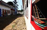 boat model at a window of the beautiful portuguese colonial typical town of parati in rio de janeiro state brazil