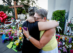 The Rev. Sharon Risher, of Dallas, Tx, is consoled as she visits the site where her mother, Ethel Lance, was killed at Emanuel AME Church Saturday, June 20, 2015 in Charleston. Paul Zoeller/Staff