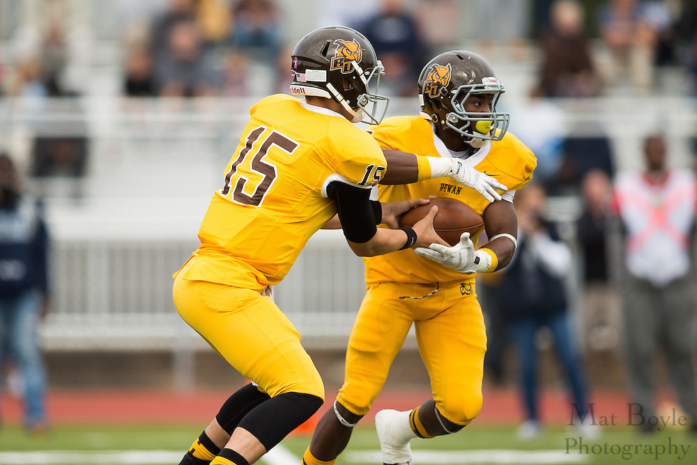Rowan University Sophomore QB Paul Hamersma (15) & Rowan University Sophomore RB Withler Marcelin (5) -  Rowan University Football vs Wesley College at Richard Wacker Stadium in Glassboro, NJ on Saturday October 19, 2013. (photo / Mat Boyle)