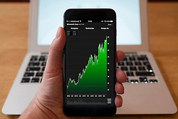 Using iPhone smartphone to display stock market performance chart for Microsoft company