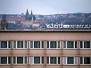 Prager Stadtpanorama - im Vordergrund die Fassade des Hotel Olympic im Kontrast zur Prager Burg. <br /> <br /> Prague urban landscape - in front Hotel Olympic in contrast to the Prague Castle.