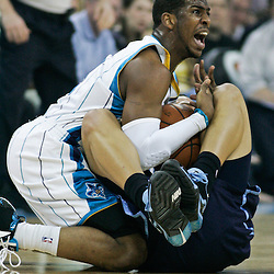 05 April 2009: New Orleans Hornets guard Chris Paul (3) tries to call time out as he fights for possession with Utah Jazz guard Deron Williams during a 108-94 loss by the New Orleans Hornets to the Utah Jazz at the New Orleans Arena in New Orleans, Louisiana.