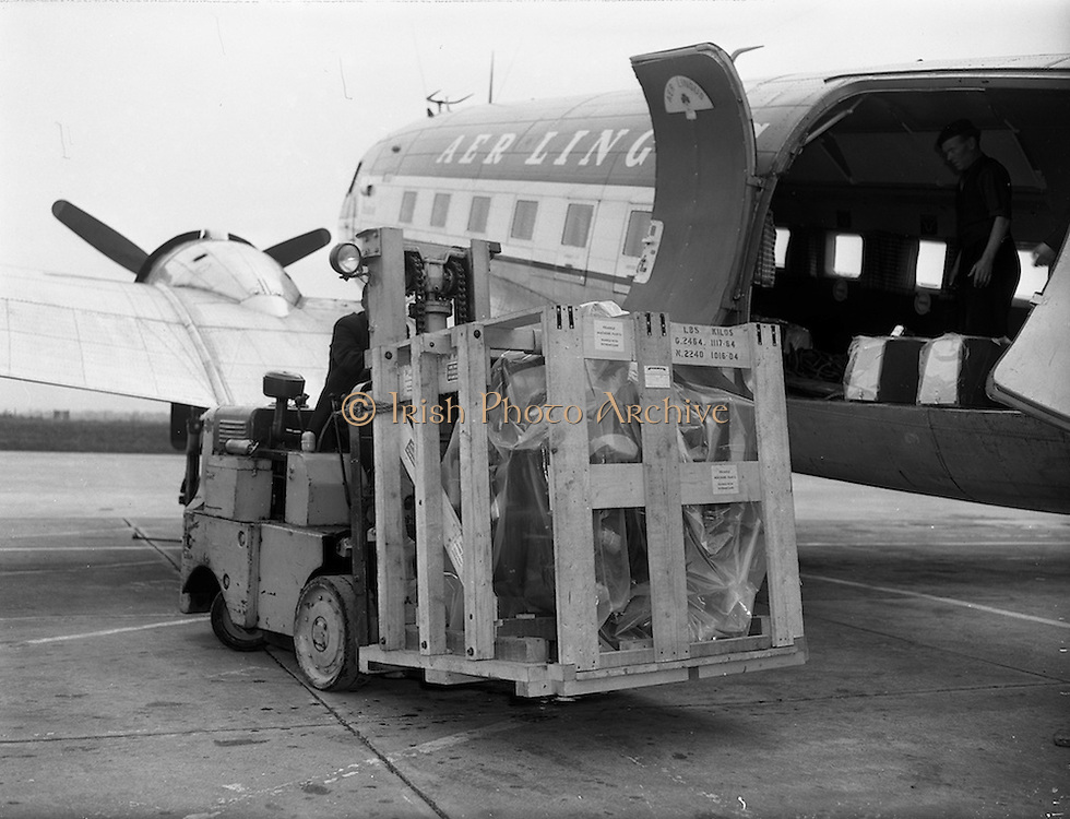 22/05/1959<br /> 05/22/1959<br /> 22 May 1959<br /> Intertype machine from London being unloaded from Aer Lingus freighter for Inter-type Ltd. at Dublin Airport. Picture shows forklift removing the machine from the planes hold.