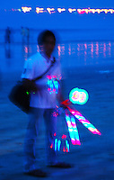 Toy light hawker on Jimbaron beach - surreal effect.