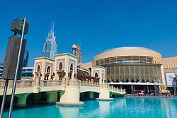 Daytime view of Dubai Mall exterior and bridge crossing pond in Downtown Dubai, United Arab Emirates, UAE