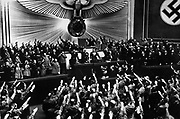 Adolf Hitler receiving an ovation in the Reichstag after announcing the peaceful acquisition of Austria Berlin, March 1938