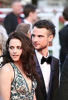 Kristen Stewart, Tom Sturridge, at the On The Road gala screening red carpet at the 65th Cannes Film Festival France. The film is based on the book of the same name by beat writer Jack Kerouak and directed by Walter Salles. Wednesday 23rd May 2012 in Cannes Film Festival, France.