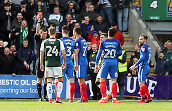 Steven Taylor of Peterborough United is shown a red card by match referee Craig Hicks for a second bookable offence - Mandatory by-line: Joe Dent/JMP - 07/04/2018 - FOOTBALL - Home Park - Plymouth, England - Plymouth Argyle v Peterborough United - Sky Bet League One