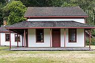 The Henry Ruckle Farmhouse was built in the 1870's with the Kitchen (left) addition added in 1884.  Photographed from the Ruckle Farm in Ruckle Provincial Park on Salt Spring Island, British Columbia, Canada.