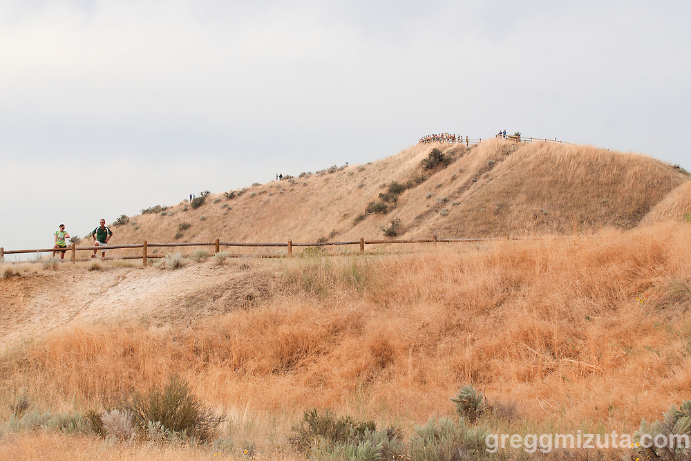 The backside of Camel's Back Park during the 2011 Camelsback Invitational at Boise, ID on August 27, 2011. Borah coaches Pam Dietz and Tim Severa watch from the lower fence line while a large group watches from the top ridge of Camel's Back Park.