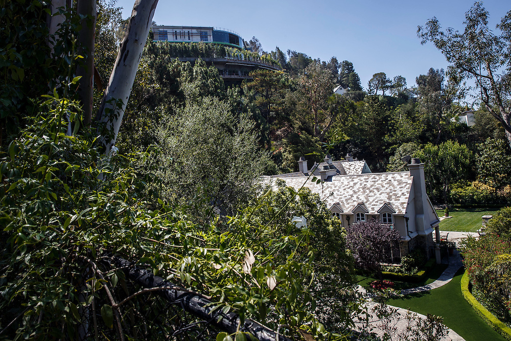 The mansion of Mohamed Hadid under construction at 901 Strada Vecchia stands above a neighbor's home in the Bel Air neighborhood on Thursday, July 16, 2015 in Los Angeles, California. Photo by Patrick T. Fallon for DailyMail.com