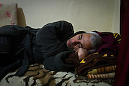Bissam sleeping at his home in Bolu, western Turkey.