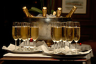 Two trays of champagne with ice bucket