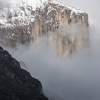 Snow and fog surround El Capitan. Yosemite National Park, California