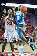 FAYETTEVILLE, AR - NOVEMBER 13:  Christopher Hyder #0 of the Southern University Jaguars drives for a layup around Moses Kingsley #33 of the Arkansas Razorbacks at Bud Walton Arena on November 13, 2015 in Fayetteville, Arkansas.  The Razorbacks defeated the Jaguars 86-68.  (Photo by Wesley Hitt/Getty Images) *** Local Caption *** Christopher Hyder; Moses Kingsley