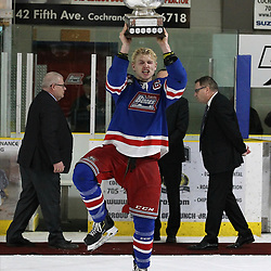 COCHRANE, ON - MAY 4: Peyton Reeves #28 of the Oakville Blades raises the Dudley Hewitt Cup on May 4, 2019 at Tim Horton Events Centre in Cochrane, Ontario, Canada.<br /> (Photo by Tim Bates / OJHL Images)