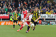 Burton Albion defender Shane Cansdell-Sherriff wins the ball during the Sky Bet League 1 match between Burton Albion and Fleetwood Town at the Pirelli Stadium, Burton upon Trent, England on 12 March 2016. Photo by Aaron  Lupton.