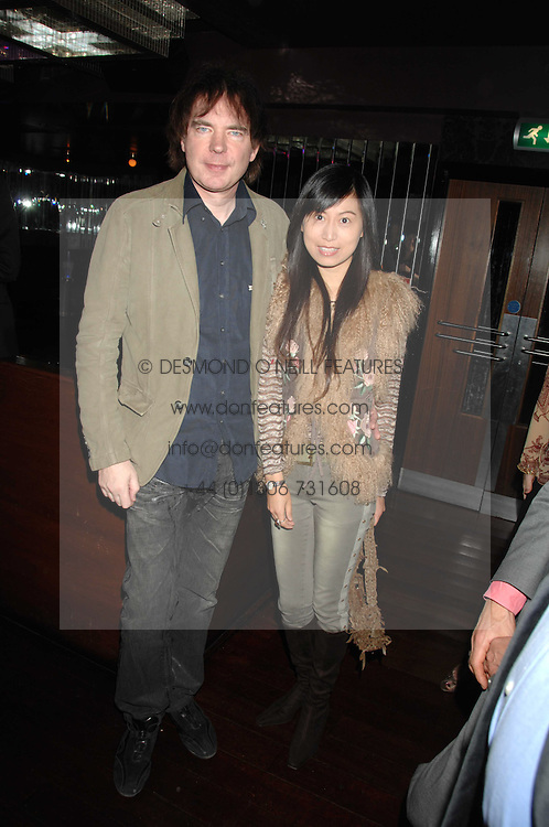 JULIAN LLOYD WEBBER and his girlfriend at a party to celebrate Imogen Lloyd Webber's 30th birthday and the launch of her Single Girl's Guide held at Vilstead, 9 Swallow Street, London on 27th March 2007.<br />