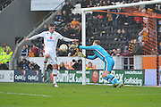 Milton Keynes Dons goalkeeper David Martin(1) saves a shot at goal from Hull City striker Abel Hernandez (9)  during the Sky Bet Championship match between Hull City and Milton Keynes Dons at the KC Stadium, Kingston upon Hull, England on 12 March 2016. Photo by Ian Lyall.