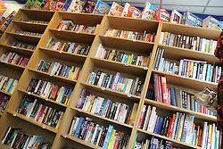 Shelves of books at a public library.