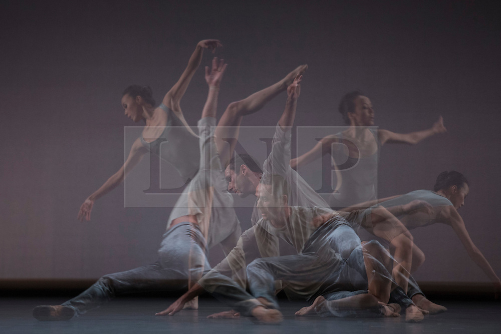 © Licensed to London News Pictures. 14/11/2013. London, England. Pictured: In-camera multiple exposures. Five Movements, Three Repeats by Christopher Wheeldon with dancers Fang-Yi Sheu, Yuan Yuan Tan, Damian Smith and Desmond Richardson. This programme is a new British-Chinese collaboration exploring where classical meets contemporary dance, featuring the  Chinese prima ballerina Yuan Yuan Tan, principal dancer with San Francisco Ballet and the Taiwanese virtuoso Fang-Yi Sheu. The evening includes three UK premieres choreographed by Taiwanese-born American Edwaard Liang, and Sadler's Wells Associate Artists Russell Maliphant and Christopher Wheeldon. Photo credit: Bettina Strenske/LNP