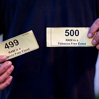 A patient displays his number 499 and 500 ticket after entering the Remote Area Medical clinic in Wise, Virginia July 20, 2012.  Organizers hope to bring free medical, dental and vision care to more than 3500 uninsured and underinsured people in the rural Virginia area.  REUTERS/Mark Makela   (UNITED STATES)