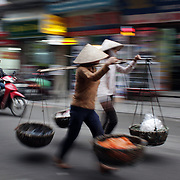 Locals carry their wears in the old quarter of Hanoi, Vietnam. Hanoi is the capital of Vietnam and the country's second largest city. Hanoi, Vietnam. 17th March 2012. Photo Tim Clayton