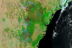 December 17, 2019 - Australia - View from Terra of the difficult fire season in Australia in southern hemisphere spring. The image at the top of the page comes from Terra's Moderate Resolution Imaging Spectroradiometer (MODIS), which observes Earth in 36 different wavelengths. Acquired on December 17, 2019, the false-color image combines visible and infrared light (bands 7-2-1) to distinguish fire burn scars (orange to brown) from healthy vegetation (green) in New South Wales. Red pixels represent areas where Terra detected heat signatures indicative of active fire. (Credit Image: © NASA Earth/ZUMA Wire/ZUMAPRESS.com)