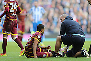 Queens Park Rangers defender Jake Bidwell (3) receives treatment for an injury during the EFL Sky Bet Championship match between Brighton and Hove Albion and Queens Park Rangers at the American Express Community Stadium, Brighton and Hove, England on 27 December 2016.