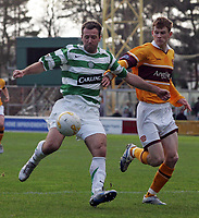 Photo: Paul Thomas.<br /> Motherwell v Glasgow Celtic. Bank of Scotland Scottish Premier League. 30/12/2006.<br /> <br /> Maciej Zurawski (L) of Celtic gets away from Mark Reynolds.