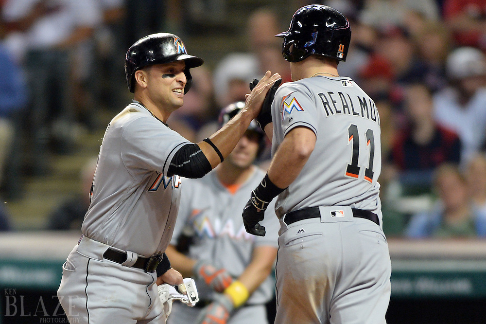 Sep 2, 2016; Cleveland, OH, USA; Miami Marlins catcher J.T. Realmuto (11) celebrates with Miami Marlins third baseman Martin Prado (14) during the eighth inning against the Cleveland Indians at Progressive Field. Mandatory Credit: Ken Blaze-USA TODAY Sports