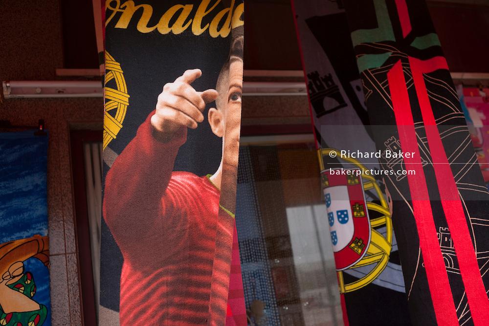 National hero, footballer Christiano Ronaldo's distorted face on beach towel merchandise, in Barra, Costa Nova, Aveiro, Portugal.