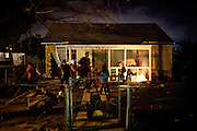 The Rutter family hangs out in front of their Parklawn home in Modesto, Calif., March 1, 2012.