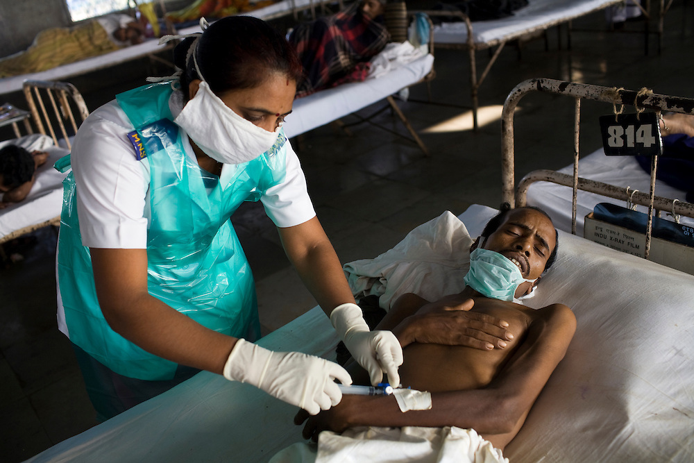 A nurse gives a daily injection to a patient at the Group of TB Hospitals in Mumbai.