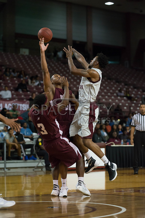 Chris Thomas of TSU makes a pass over two Alabama A&M defenders. TSU defeats Alabama A&M 77-54 at the HP&E Arena in Houston, Texas. Photo By: Jerome Hicks/ Space City Images