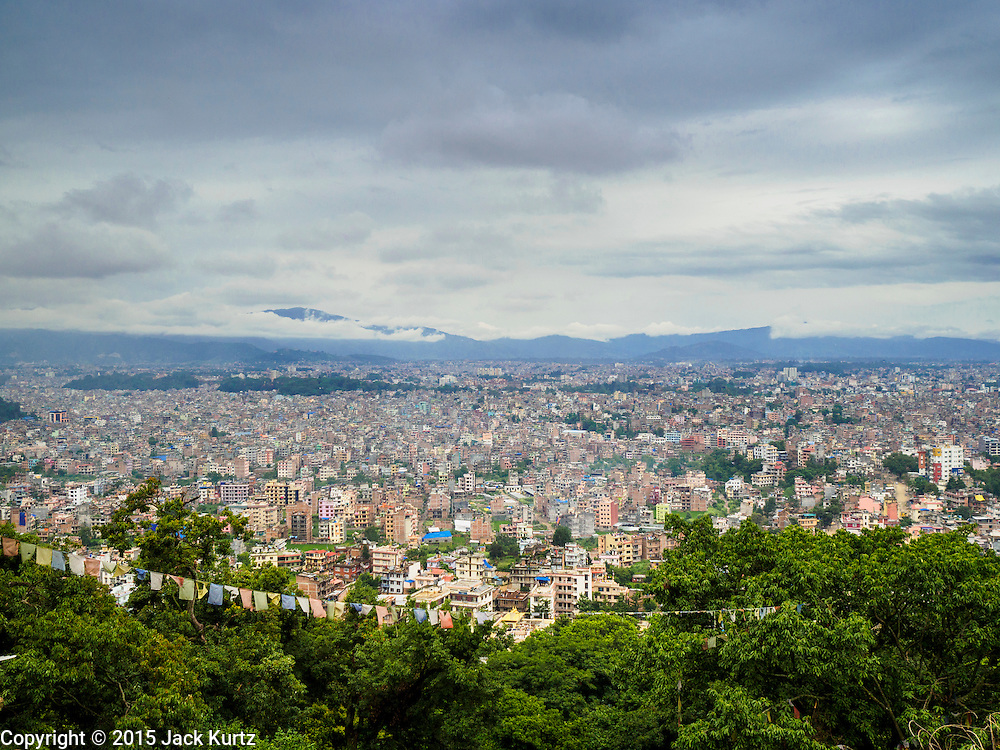 31 JULY 2015 - KATHMANDU, NEPAL:  An overview of Kathmandu, Nepal as seen from Swayambhunath Stupa, a large Buddhist stupa in Kathmandu. Parts of the stupa were badly damaged in the Nepal earthquake of 2015 but it is still open for religious devotees and tourists.    PHOTO BY JACK KURTZ
