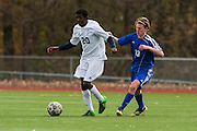 Burlington's Julian Segar-Reed (20) runs past Mount Anthony's Matthew Pellon (13) with the ball during the quarterfinal boys soccer game between Mount Anthony and Burlington at Buck Hard Field on Friday afternoon October 23, 2015 in Burlington. (BRIAN JENKINS/ for the FREE PRESS)