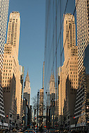 New York - mirror reflection on 42nd street, a corridor beetween skyscrappers.