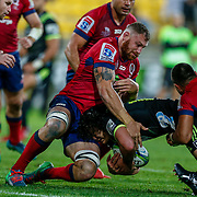 Scott Higginbotham (captain) tackles Peter Umaga-Jensen during the Super rugby union game (Round 14) played between Hurricanes v Reds, on 18 May 2018, at Westpac Stadium, Wellington, New  Zealand.    Hurricanes won 38-34.