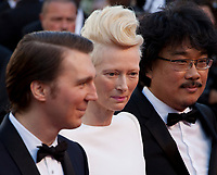 Paul Dano, Tilda Swinton and Bong Joon Ho at the Okja gala screening,  at the 70th Cannes Film Festival Friday 19th May 2017, Cannes, France. Photo credit: Doreen Kennedy