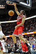 Apr 19, 2010; Cleveland, OH, USA; Chicago Bulls center Joakim Noah (13) dunks against the Cleveland Cavaliers during the fourth period in game two in the first round of the 2010 NBA playoffs at Quicken Loans Arena. The Cavaliers beat the Bulls 112-102. Mandatory Credit: Jason Miller-US PRESSWIRE