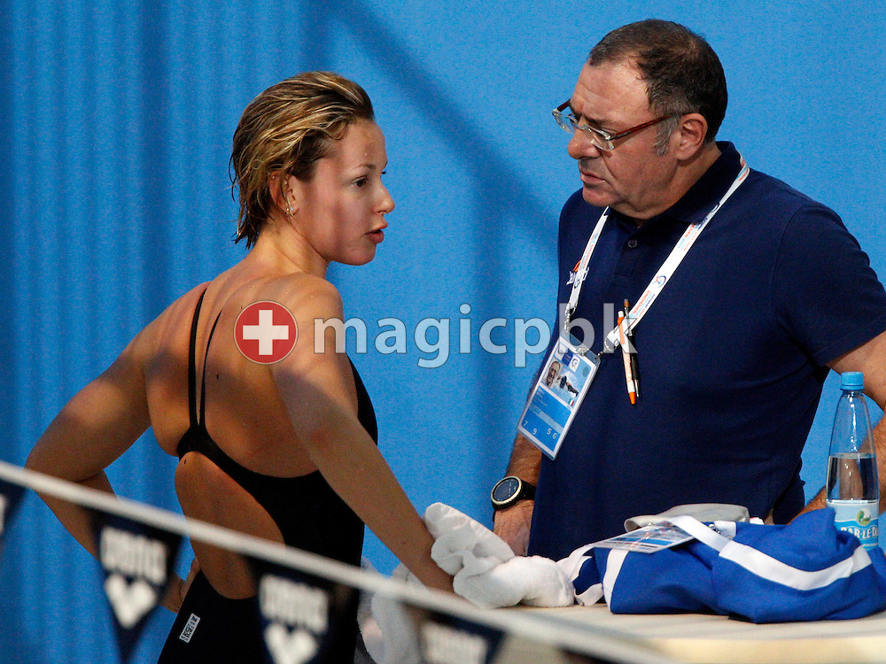 Federica PELLEGRINI (L) of Italy talks to her coach Stefano Morini (R) after she stopped after 150m in the women's 400m Freestyle Heats at the 14th European Short Course Swimming Championships in Eindhoven, The Netherlands, Saturday, Nov. 27, 2010. (Photo by Patrick B. Kraemer / MAGICPBK)
