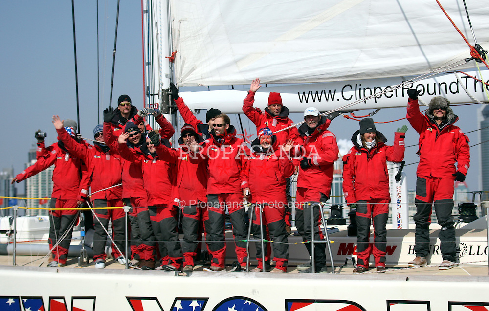 QUINDAO, CHINA - Saturday, February 16, 2008: Crew members of ocean racing yacht 'New York' stand on the deck as they sail towards Qingdao 2008 Olympic Regatta Center. 'New York' ocean racing yacht is the first during the Singapore to Qingdao racing. The international fleet of 10 ocean racing yachts sailing from Singapore make a stopover in Qingdao, the city state being the sixth of 14 cities to welcome the clippers, which are in a 10-month-long race that ends in July.