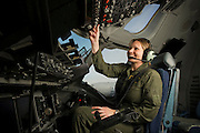 A U.S. Air Force pilot conducts her preflight checklist during engine start up on the flightdeck...Air Force aircraft transport most of the supplies and military equipment to the combat zone. Specialists must weigh, sort and load all of the gear before it heads to its location abroad. Air Force loadmasters and pilots ensure the safe transport of all equipment required in the field.