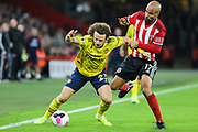 Arsenal defender David Luiz (23) goes down under pressure from Sheffield United forward David McGoldrick (17) during the Premier League match between Sheffield United and Arsenal at Bramall Lane, Sheffield, England on 21 October 2019.