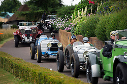 © Licensed to London News Pictures. 13/07/2015. Epsom, UK. Racegoers prepare to start the race. The start of The Royal Automobile Club 1000 Mile Trial 2015 at Woodcote Park in Epsom, Surrey. The event, which starts and finishes at Woodcote Park, takes a fleet of over 40 classic cars from around the world, through a 1000 mile trial around the UK.  Photo credit: Ben Cawthra/LNP